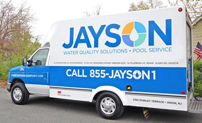 Photo of a new blue & white Jayson service truck featuring a large Jayson logo on the truck side
