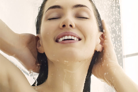 Soft, silky hair & softer, moister skin being enjoyed by the woman in a photo, while in the shower.